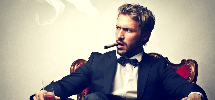 Man in suit in a cigar lounge