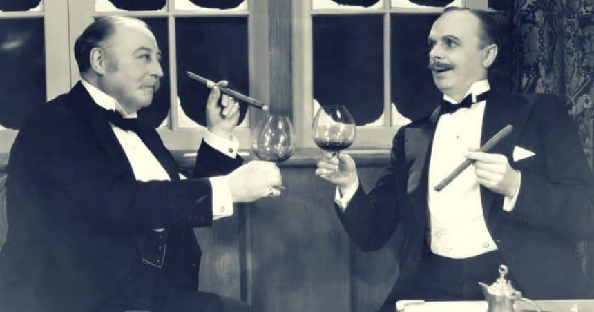 Two men drinking wine and smoking cigars vintage bromance