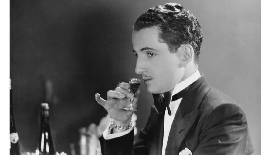 Man in suit smelling liquor - black and white vintage