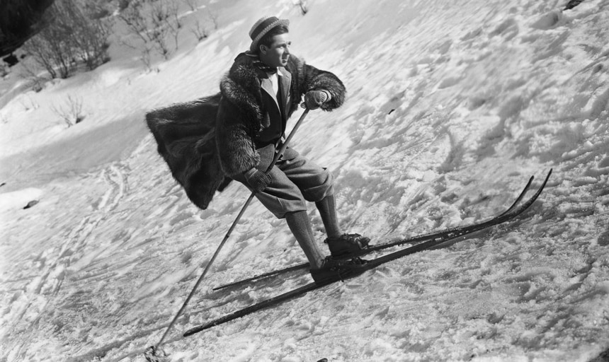 Man skiing with hat and coat on - black and white vintage style image