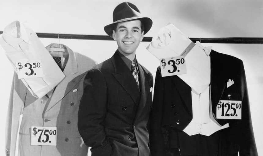 Sartorial business man surrounded by retail fashion items - black and white vintage