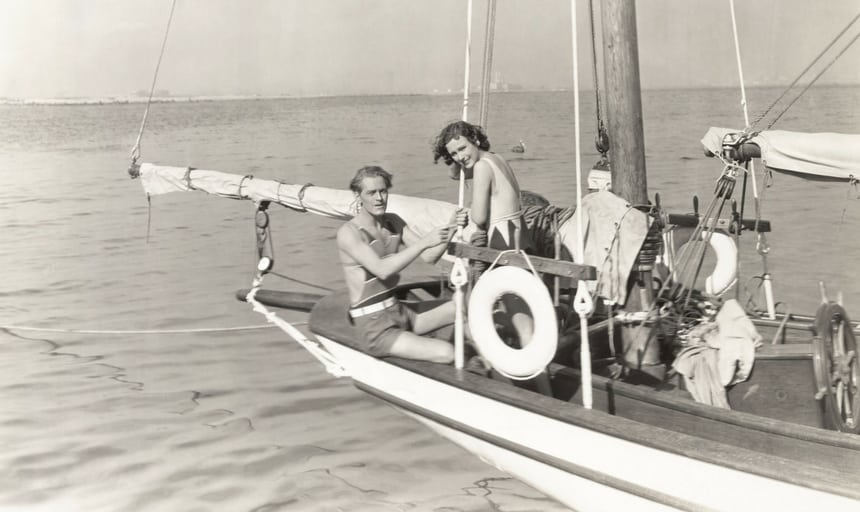 Vintage shot of a man and woman sailing
