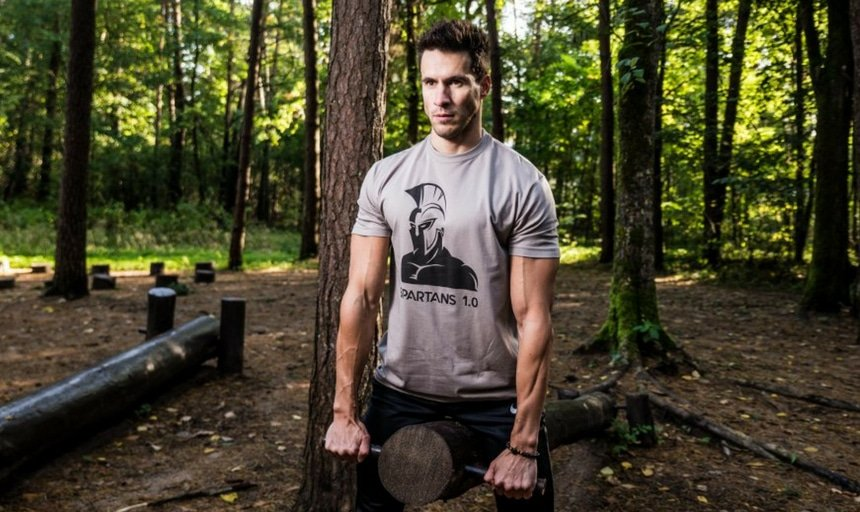guy working out outdoors with Spartans shirt on
