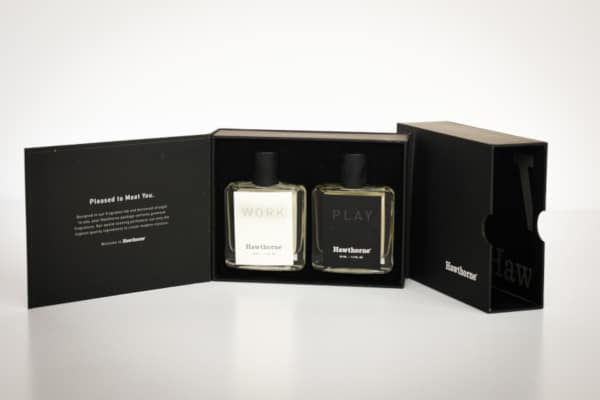 Hawthorne Fragrance Box Packaging Open Showing Work and Play Side by Side With Package in Background on Angle Smaller Size
