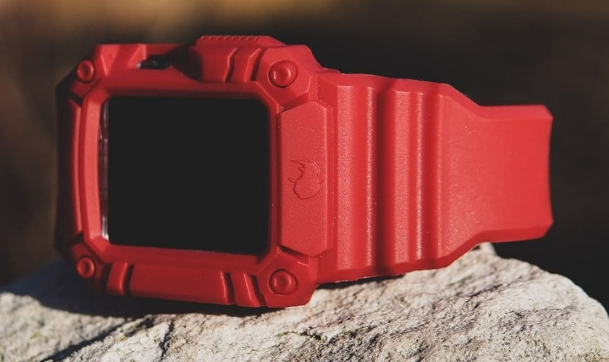Rhino Band Runner Red on side with grooves showing and sitting on a rock outdoors