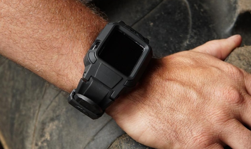 Rhino Band Stealth black on wrist holding stone up close