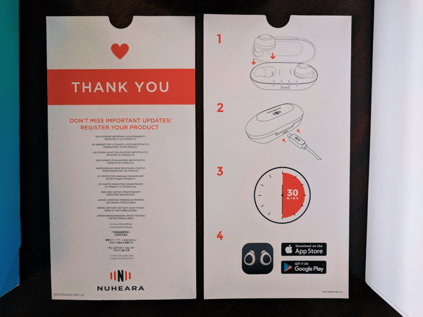 Top down close up Nuheara IQbuds Boost set quick guide and Thank you note
