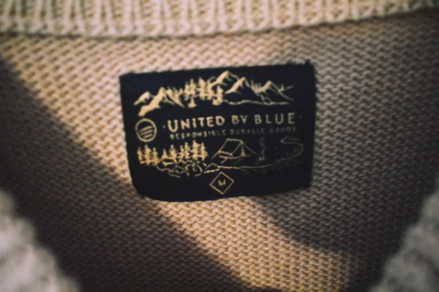 United By Blue Langford Sweater Tan Close Up Tag