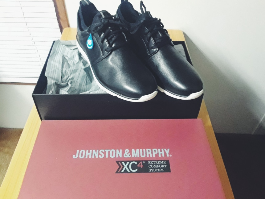 Johnston And Murphy XC4 Prentiss Plain Toe Shoe Sitting On Box Open