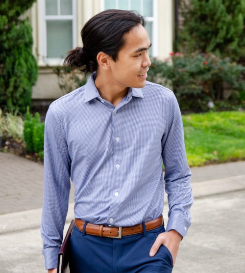 Model Wearing Mizzen+Main Beckett Dress Shirt with Hand in Pockets and Holding a Folder