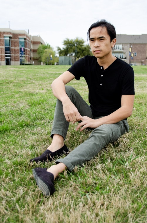 Model Wearing Mizzen+Main Tohono Henley Sitting Down in Park