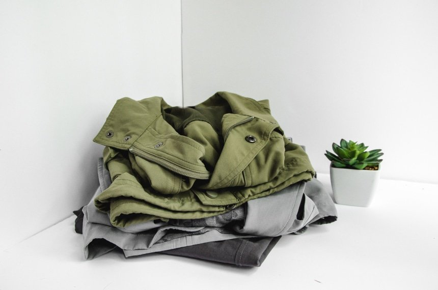 TravelSmith Clothes Piled Up Featuring Voyager Vest, Travel Blazer by Territory Ahead and Flyaway Pants