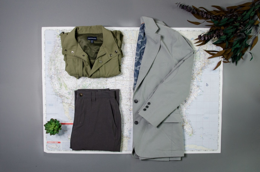 TravelSmith Collage Featuring Voyager Vest, Travel Blazer by Territory Ahead and Flyaway Pants Sitting on Top of Map
