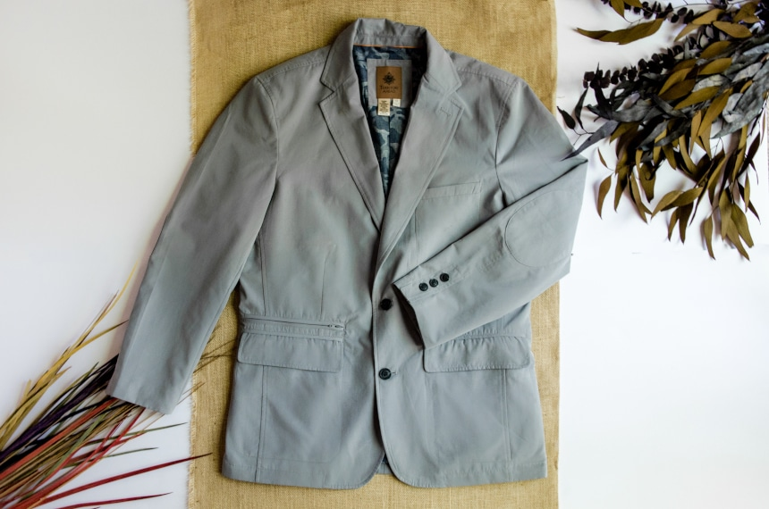 TravelSmith On The Fly Lightweight Year Round Travel Blazer by Territory Ahead in Grey By Itself With Arm Folded on Canvas Background