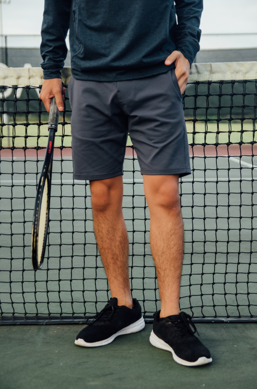 Leg Shot Of Model Wearing Public Rec All Day Every Day Short Holding Tennis Racquet