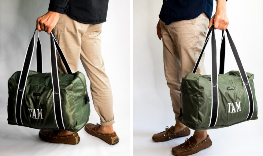 Model Holding Paravel Safari Green Fold-Up Bag in Grid and Moving Forward Side Angles