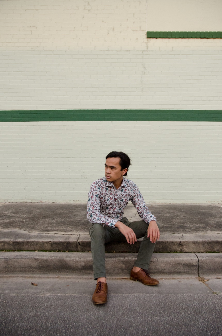 Model Wearing Apposta 100% Pure Cotton Poplin Floral And Sitting On Street