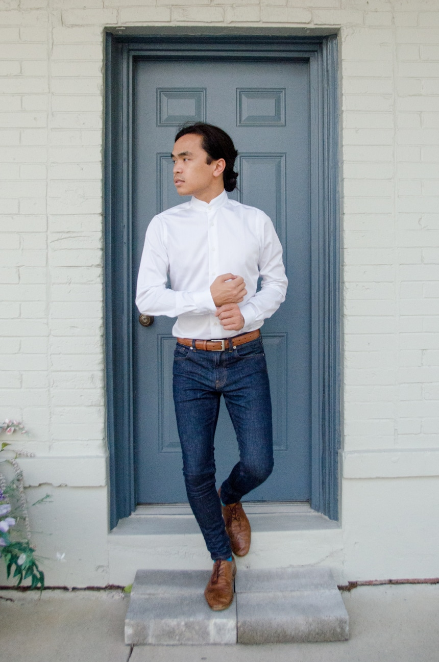 Model Wearing Apposta Coolmax Twill And Standing On Stoop With Shirt Tucked Into Jeans