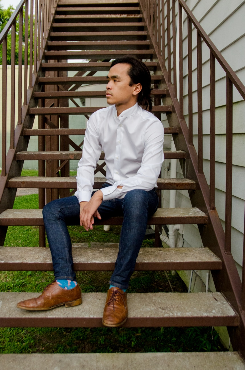 Model Wearing Apposta Coolmax Twill and Sitting On Stairs Wearing Jeans and Boots