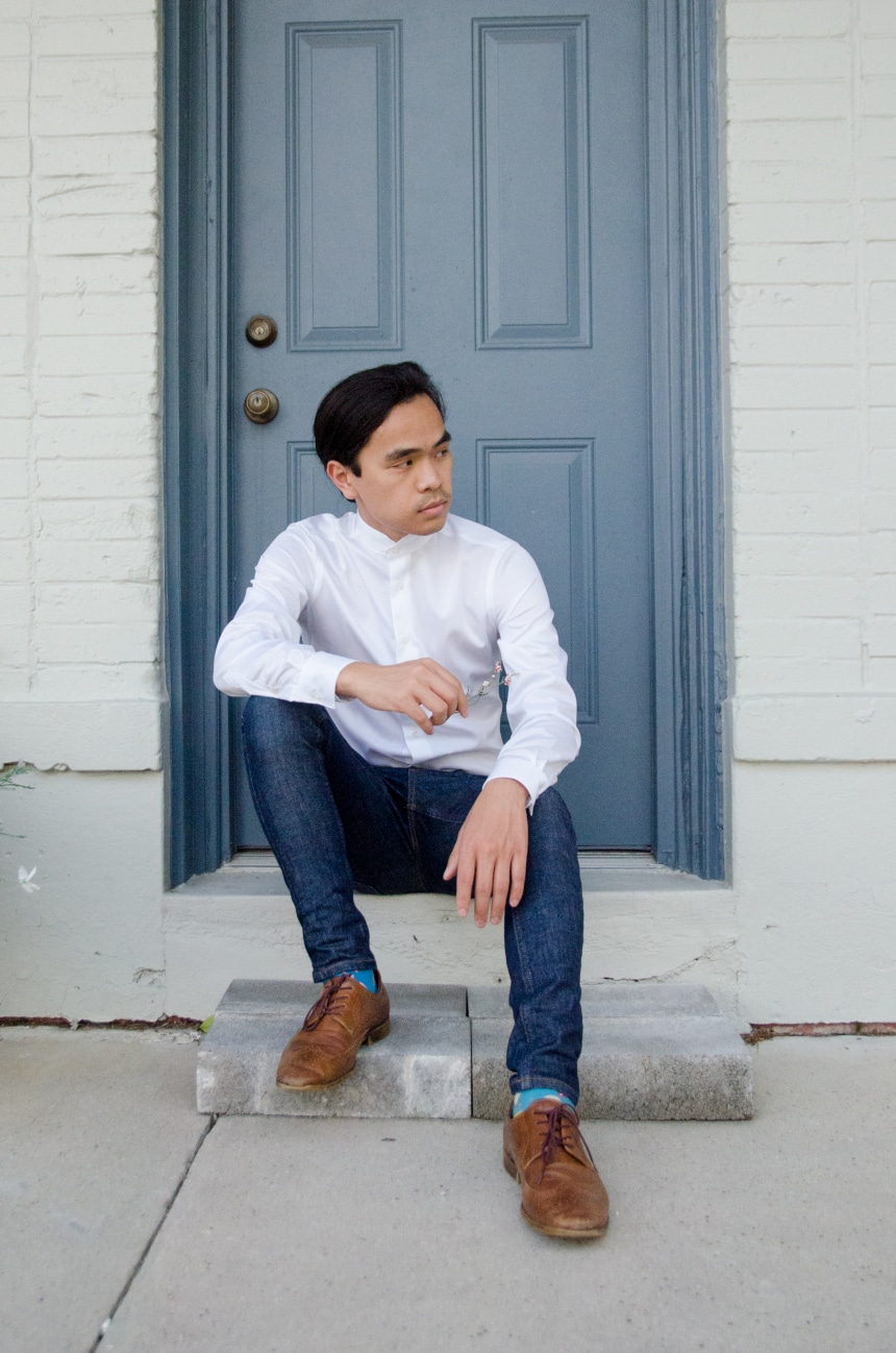 Model Wearing Apposta Coolmax Twill and Sitting On Stoop Wearing Jeans and Boots