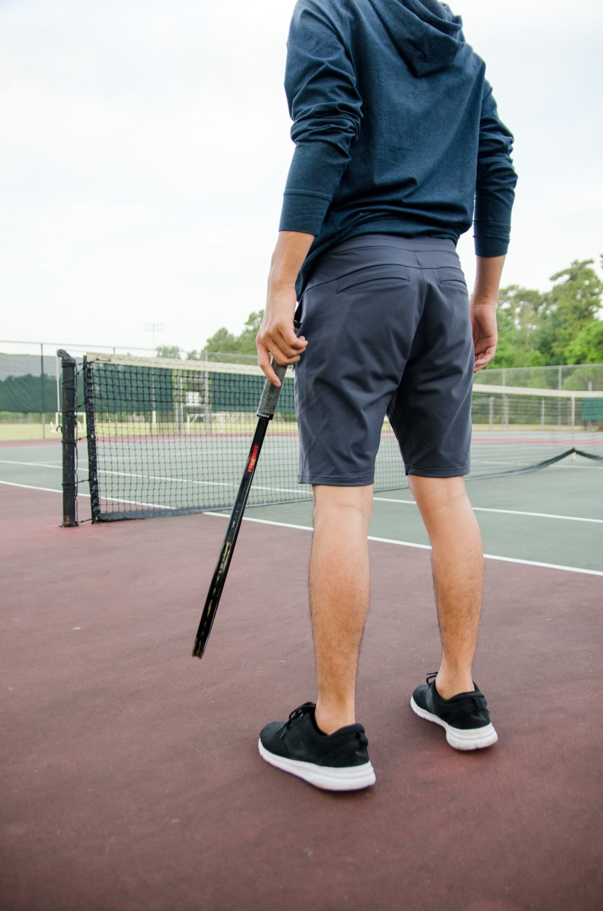 Reverse Shot Of Model Wearing Public Rec All Day Every Day Short Holding Tennis Racquet