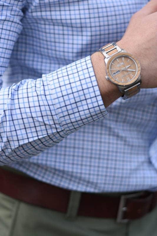 closeup of model wearing wooden watch
