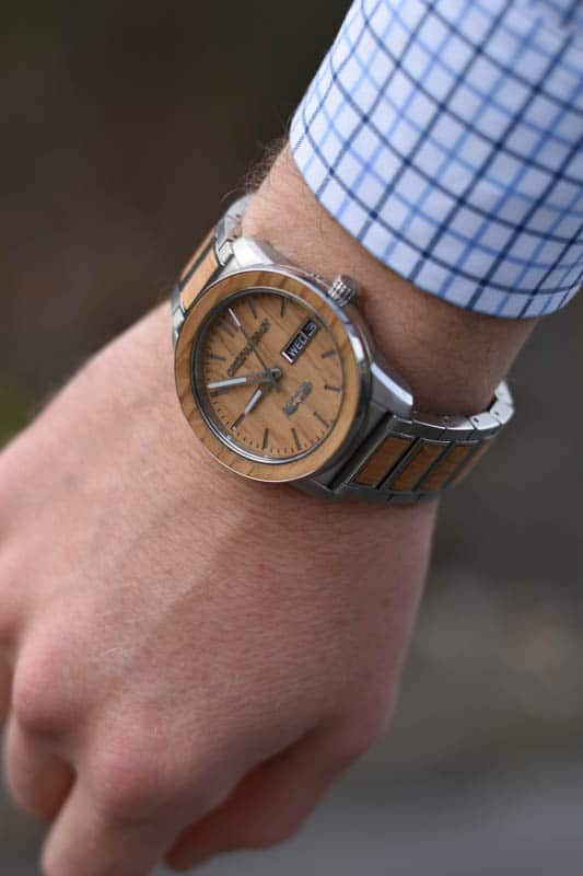 closeup of original grain barrel watch on wrist