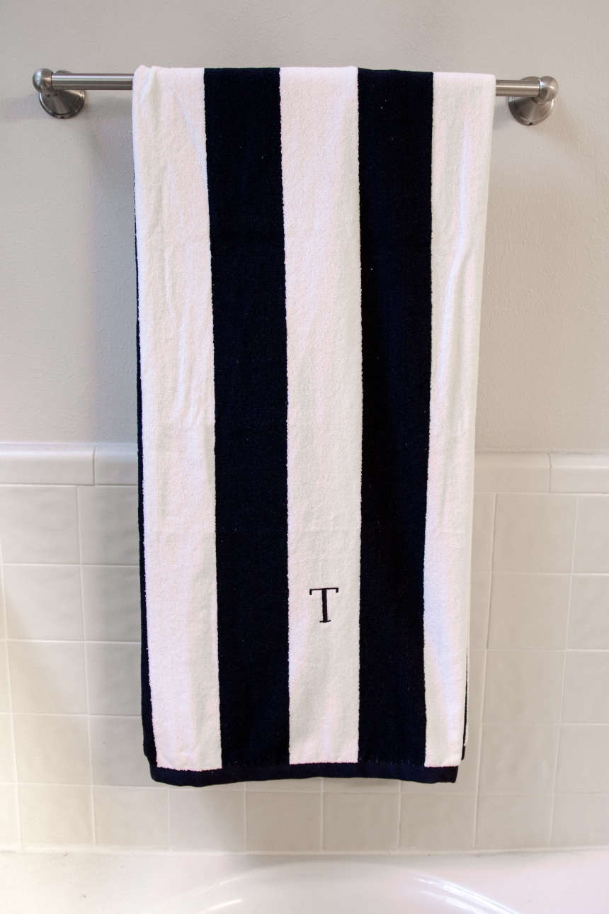 Luxor Linens Anatalya Egyptian Cotton Resort Beach Towel on towel rack