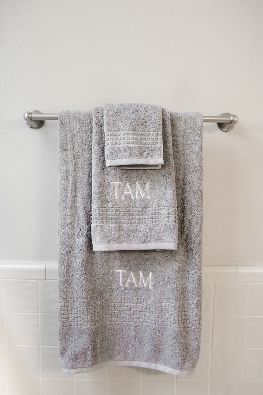 Luxor Linens Valentino Luxe Egyptian Cotton Spa Towels Monogrammed and hanging on rack front on