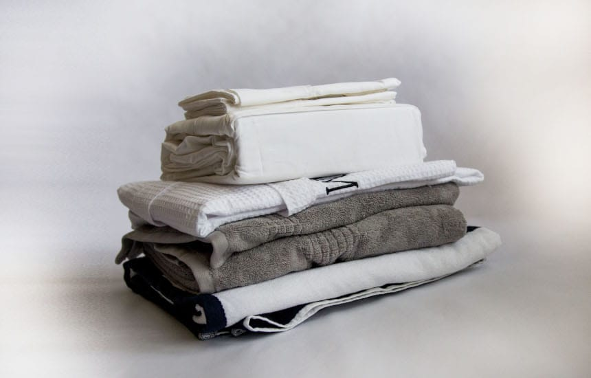 Multiple Luxor Linens products stacked including Bed Scrunchie