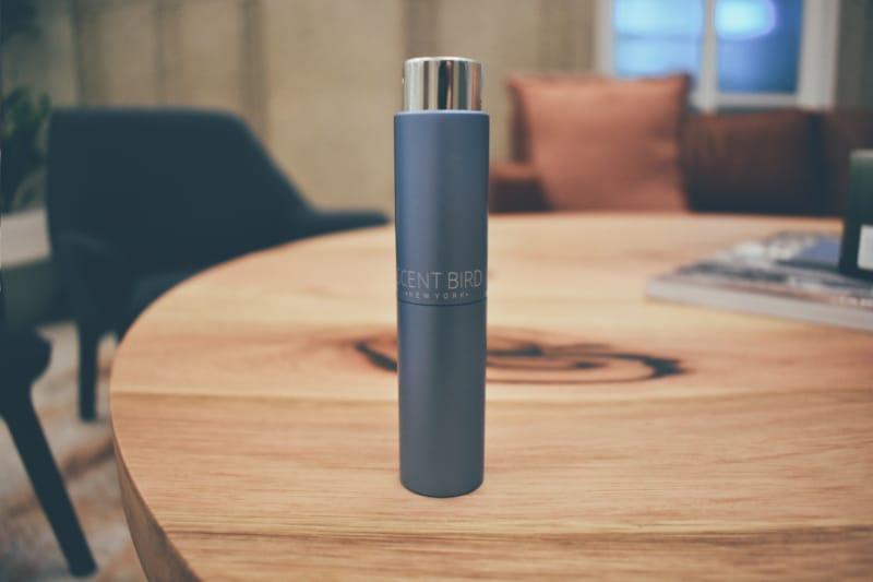 Picture of Scentbird Purple Men's Fragrance Sample Sitting on Bench in Corporate Setting