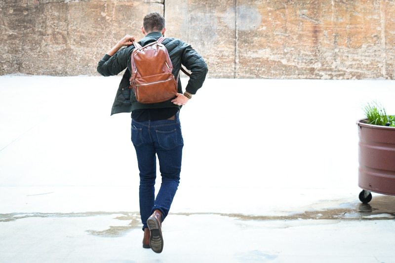 modern made man leather backpack on back