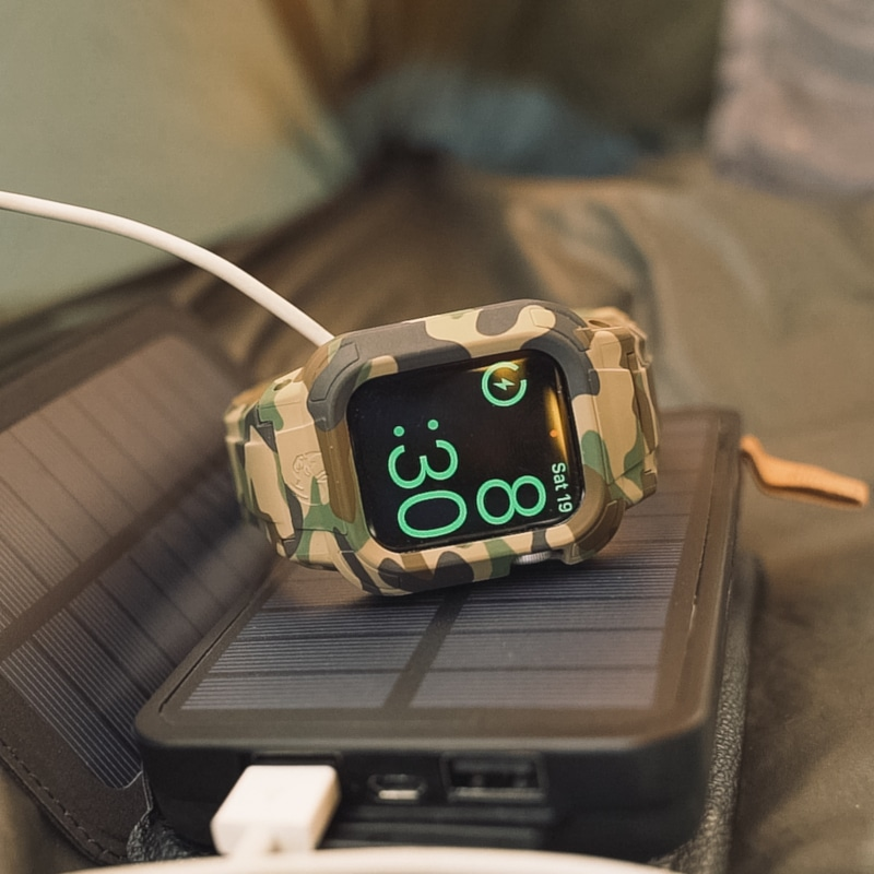 Rhino Band Stealth 44mm on its side Camo color sitting on iPhone