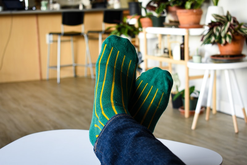 green and gold lignes dor pair of thieves socks on model