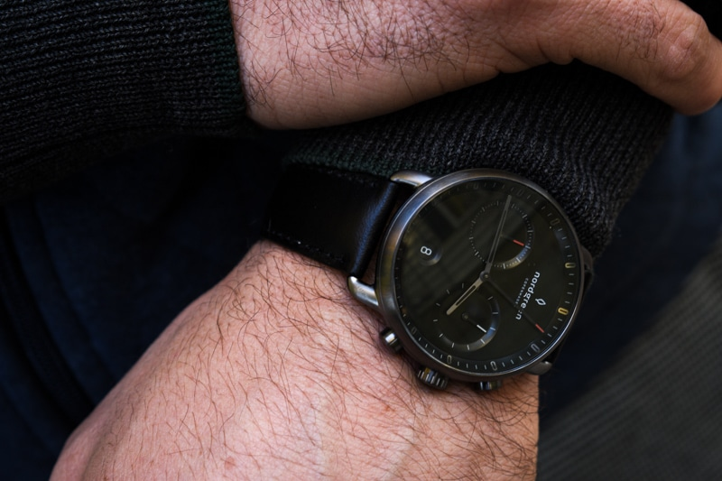 model wearing black dial pioneer