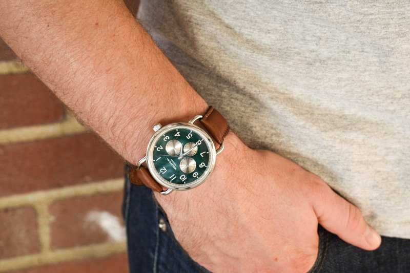 model wearing wolfpoint fort dearborn hand in pocket
