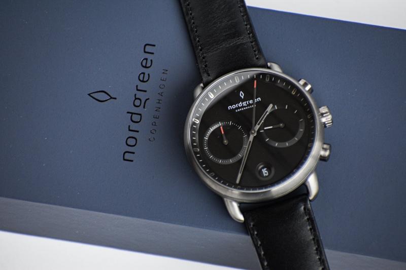 nordgreen pioneer black dial against blue packaging