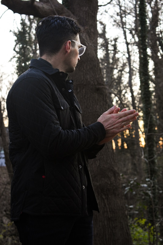 model warming hands wearing quilted jacket