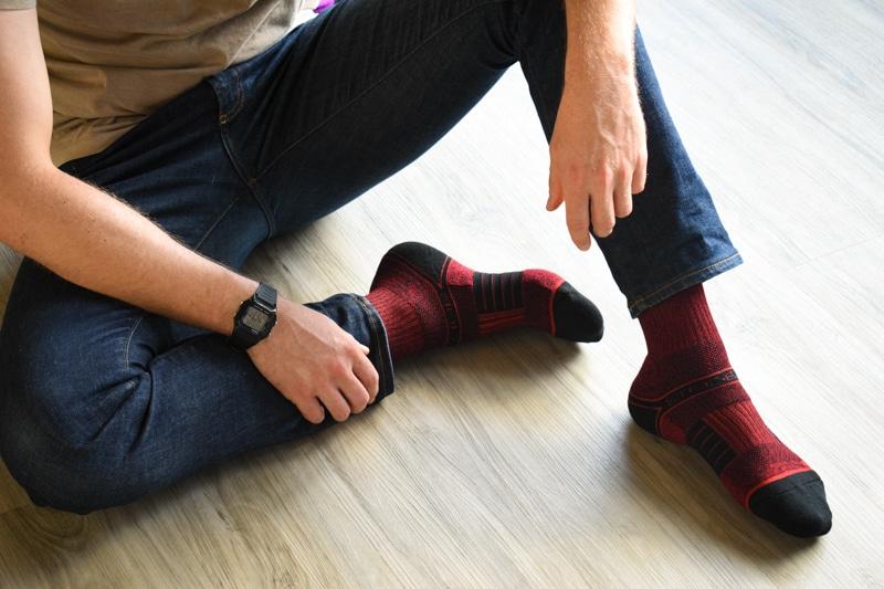 model wearing strideline red ekg socks