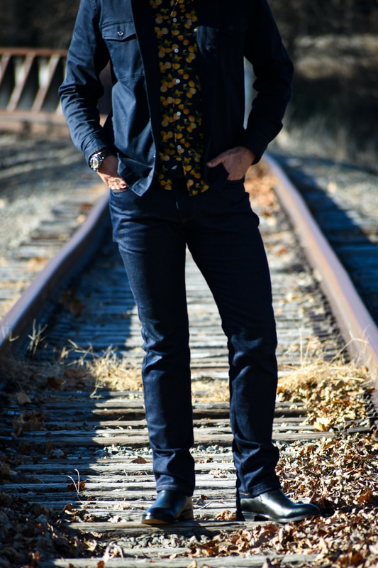 torso and legs of model wearing dark blue jeans