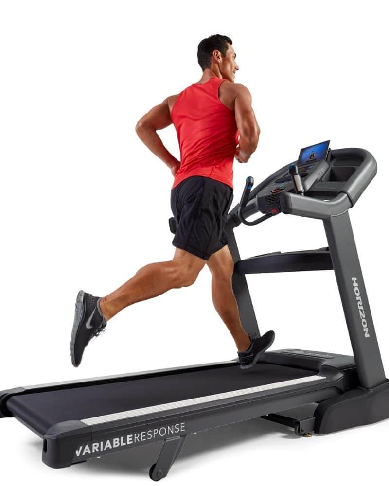man in red shirt running on treadmill