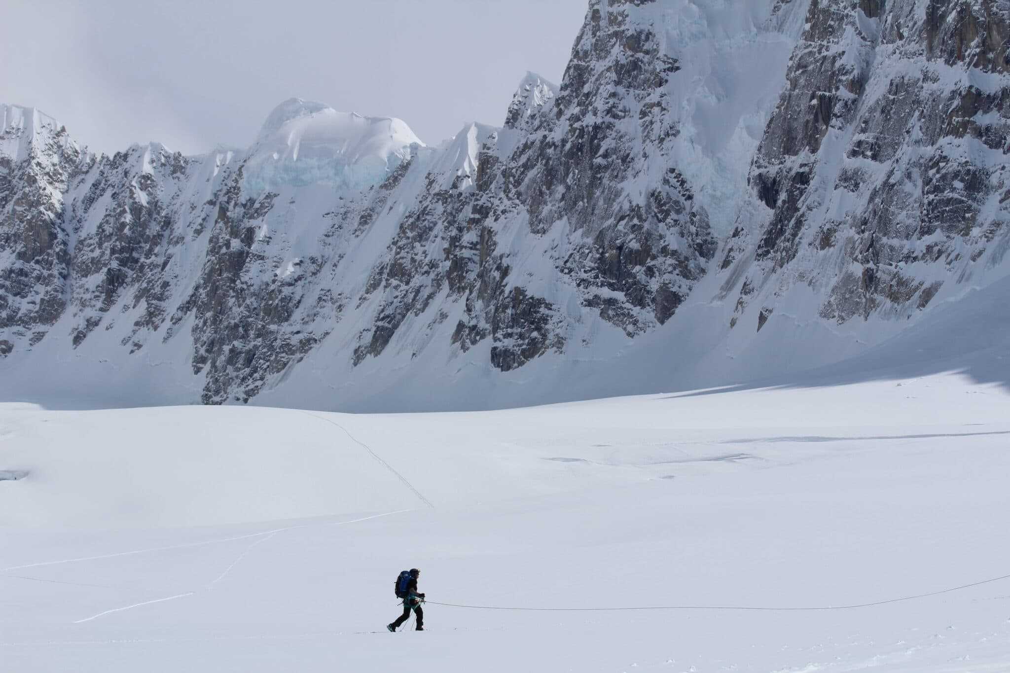 Denali Basecamp lone man against white mountain travis khachatoorian