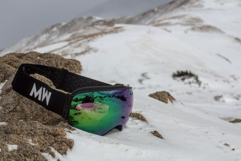 Float goggle on mountain in snow