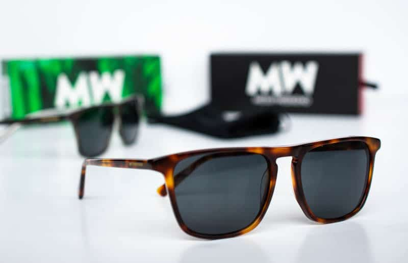 angled jack sunglasses tortoise shell color with green and black boxes on white background