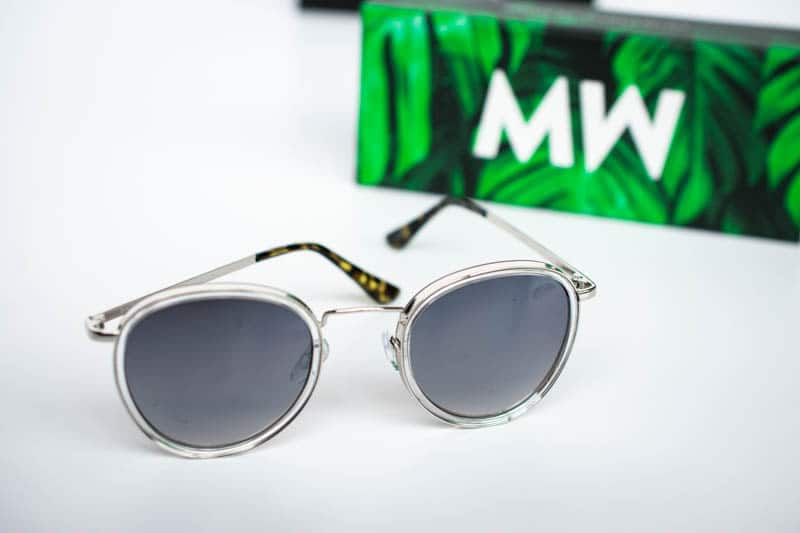 chrome shackleton messyweekend sunglasses with green case on white background