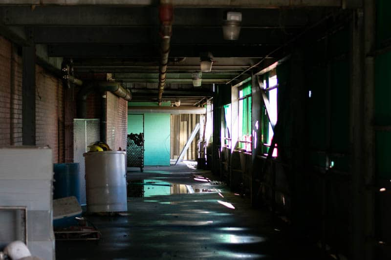 cone mill white oak plant long defunct hallway with puddles