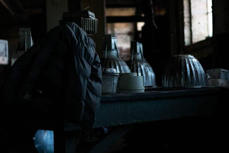 cone mills white oak plant jacket draped on lights
