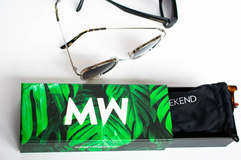 messyweekend packaging with green box black microfiber pouch and three sunglasses