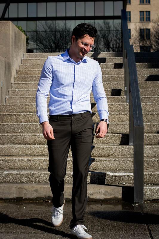 model walking down stairs wearing truwear prodigy pants and performance dress shirt