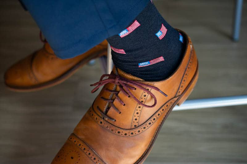 model wearing american flag socks blue tone